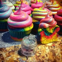Fantasy Vanilla Almond Rainbow Cupcakes...  Great cake recipe (make boxed mix taste like it's from scratch) and yummy marshmallow butter cream recipe.