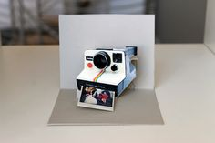 Polaroid card tutorial!!  Too adorable:  http://www.brit.co/weddings/pop-goes-the-diy-pop-up-name-card/