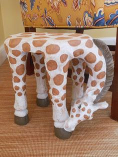 Feel like a giant, with your feet resting on this whimsical giraffe-shaped stool...