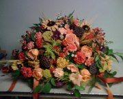 Flower Arrangements fall sympathy  funeral casket saddle