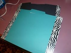 all that cute duck tape I have is now put to an even better use--tape folders shut for storage of activities