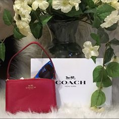"""Authentic coach signature wristlet Authentic coach leather signature wristlet . Bag length 6"""" strap length 6.5"""" bag height 4"""" bag is red Comes with coach gift box and tissue paper. Coach Bags Clutches & Wristlets"""