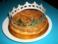 "Gallete des Rois...one of my favorite cultural deserts...for Three Kings Day the french make an almond paste cake with a tiny ""feve"" or a small porcelain figure baked into it...whom ever gets the ""feve"" becomes the king or queen for the day :D"