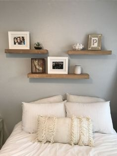 3 shelves above bed. White and grey bedroom. Fun room makeover :)