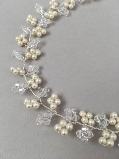 DETAILS | A beautiful simple hair vine featuring Swarovski crystals and crystal pearls in a leafy design. STYLING | The Iris hair vine would perfectly sit as a head band in hair that has been partially secured into a structured style or can alternatively be pinned into a low modern