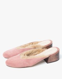 From Mari Giudicelli, timeless mules in Coral. Suede upper. Carved wooden block…