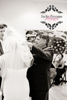 Dad giving bride away. Indoor ceremony.  Classic Southern Wedding at art gallery and historic home.   Photography:  Andie Freeman Photography www.TheAthensWeddingPhotographer.com Event Coordinator: www.WildflowerEventServices.com Event design and Catering:  Mama's Boy Venue:  Lyndon House Arts Center
