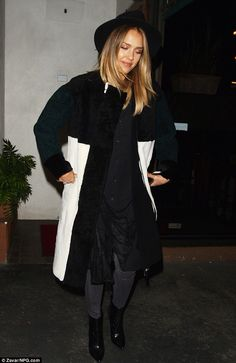 Jessica Alba - statement monochrome winter coat with a pared back ensemble consisting of a black blouse and Current/Elliot snakeskin jeans.