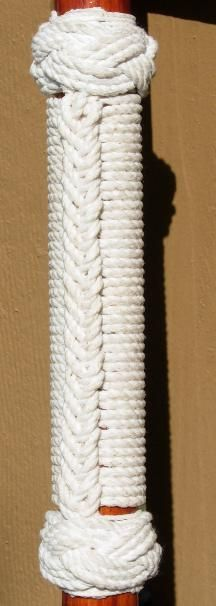 Ring Bolt Hitching: A beautiful form of knotting that can be used to decorate and add grip to walking sticks, chairs, purse handles, whatever your desire. http://www.morethanknots.com/WS/WS_2.html