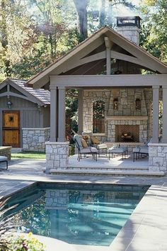 Traditional Porch with exterior stone floors, Paint, Stacked stone fireplace, Fence, Barn door, Gazebo, Reflection pool