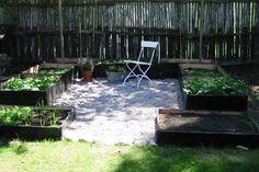 white pebbles, raised garden beds