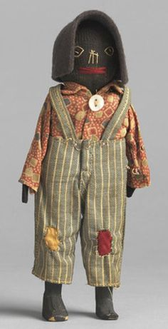 Black Folk Art Doll With Embroidered Face - American 1880.