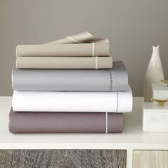 NEW! Understated elegance. Edges bordered with subtle scalloped embroidery add a layer of luxury to this 350-thread count Organic Sateen Sheet Set.