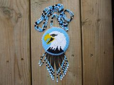 native eagle medallion by deancouchie Bead Embroidery Patterns, Beaded Embroidery, Beading Patterns, Beading Ideas, Feather Earrings, Beaded Earrings, Beaded Jewelry, Beadwork Designs, Native American Beadwork