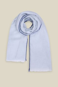 The gorgeous Lovely In Linen scarf really is true to its name. The lightweight cotton scarf in blue glow was inspired by the Wiltshire Water Meadow. The scarf features a stripe of deeper blue along the trimming, finishing with a ruffled edge.   100% Linen