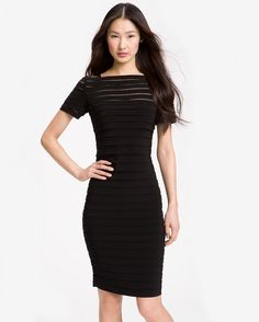 """Sheer mesh peeks unexpectedly from between the pleats at the top of a jersey sheath cut for a shapely, hourglass silhouette - Approx. length from shoulder to hem: regular 38""""; petite 35"""". - Measuremen"""