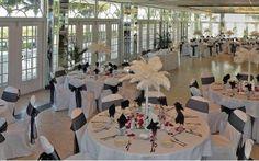 Open Ballroom with white Palm tree centerpieces.  White and Black wedding.  Grand Plaza Resort, St Pete Beach, Fl.