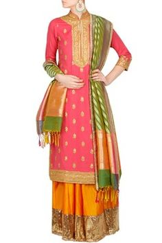 Featuring a salmon pink bandh gala straight kurta in cotton jute with gold sequin and dori embroidery along neckline and border. It has floral bootis scatter and key hole detailing in the front. It comes along with a mehendi green and coral banarasi silk dupatta with thread tassels. It also comes along with a pair of orange flared silk palazo pants with antique gold broad gota border by AMBRISH DAMANI Shop now-www.carmaonlineshop.com