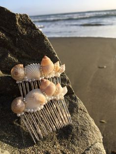 Beach style hair stick made with sand and shell.