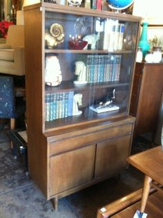 This compact mid-century china cabinet is perfect for a studio or small dining room. The cabinet has glass covered upper shelves, a large drawer for linens or silverware, and cabinet space below. Small Loft, China Cabinets, Cabinet Space, Vintage Storage, Large Drawers, Small Dining, Vintage Furniture, Linens, Tea Party