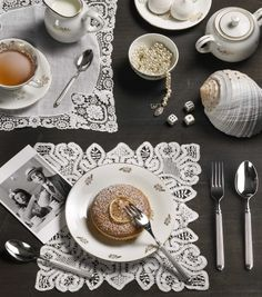 ELLADE-  Absolute quality combined with the design: classic, bright and elegant cutIery  #Pintinox #posate #cutlery #miseenplace #Ellade #white #lace #teatime #pearls #shell #sweets #cake #polaroid