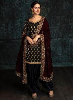 Black Brocade Punjabi Suit with Wine Shawl features a brocade kameez, satin kameez and velvet shawl dupatta. Embroidery work is completed with zari and stone work embellishments. Punjabi Salwar Suits, Punjabi Dress, Patiala Suit, Pakistani Dresses, Indian Dresses, Indian Outfits, Designer Salwar Kameez, Shalwar Kameez, Velvet Shawl