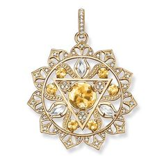 The Manipura solar plexus chakra strengthens willpower and personality. #THOMASSABO pendant crafted from 18k yellow gold with yellow quartz, milky quartz and white #diamonds.