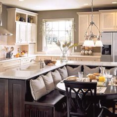 My dream kitchen remodel! wow really love the bench seating with table in front of island
