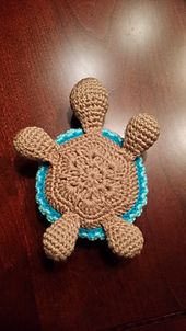 ...Press opening flat with your fingers and close the 2 sides with 3 sc across the opening. Leave a long tail for sewing to the body. Baby Turtle Head: Rnd 1: 6...