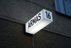 Armas (signage) — Aleksi Hautamäki, black and white, blade, internal illumination Signage Display, Retail Signage, Wayfinding Signage, Signage Design, Hotel Signage, Retail Branding, Blade Sign, Company Signage, Sign Board Design