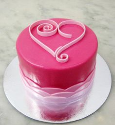 Quilled Heart Cake Valrhona chocolate cake filled with raspberry buttercream, iced in a deep pink rolled fondant, finished with a quilled su...