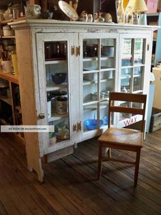 1920s Kitchen Cabinets   Primitive Glass Doored Kitchen Cabinet Ca. 1920 1900-1950   A place for my dishes.