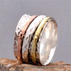 Silver spinner rings.Spinner Rings,Meditation Rings, Wish Rings,Prayer Rings.The Meditation Ring is based on the ancient Tibetan Prayer Wheels. Spinning Rings by Dynamic Jewelry