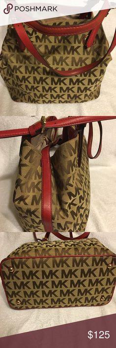 Michael Kors beautiful hand bag Tan signature Michael Kors purse with dark red leather trim and handles with a gold MK metal  hanging emblem MICHAEL Michael Kors Bags