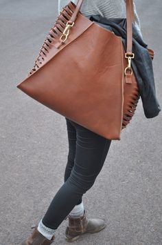 All bags are hand made with Genuine leather in Sisters, Oregon. Each item  is made to order and may take 4 to 5 business days to complete.      * High quality SB Foot Leather     * Solid Brass Hardware     * Handmade     * Colors vary based on what J Paige & Co has in stock