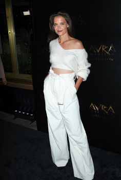 New York, NY - New York, NY - Katie Holmes rocks white after Labor Day sporting flared high waisted slacks and a white off the shoulder crop top. The 37-year-old actress exudes confidence as she poses for the cameras.  AKM-GSI 8 SEPTEMBER 2016 To License These Photos, Please Contact : Maria Buda (917) 242-1505 mbuda@akmgsi.comor  Mark Satter (317) 691-9592 msatter@akmgsi.com sales@akmgsi.com