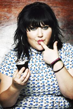 Beth Ditto eating a cupcake...one of my other idols. She is comfortable with herself.