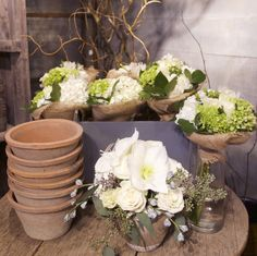 Whites and browns make a chic combination.   http://shop.rogersgardens.com/browse.cfm/floral-arrangements/2,230.html?_ga=1.155569211.1480954403.1432337028
