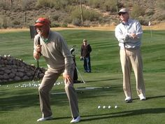 Celebs in action: World No. 3 teaching pro Jim McLean and TV reporter- legend explaining the game..