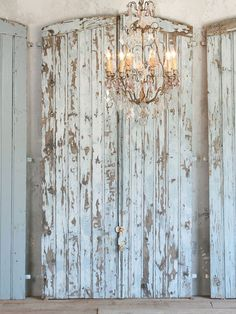 Vintage Barn Doors-love them as a backdrop to the chandelier!This old door has a great Shabby Chic worn white finish. - May 18 2019 at Distressed Furniture, Painted Furniture, Diy Furniture, Distressed Doors, Cottage Furniture, Home Decoracion, Old Doors, Barn Doors, Garage Doors