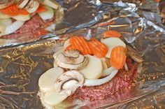 hamburger foil dinner (can make this in the oven too)...reminds me of when i was younger and my parents made these! Yummy!