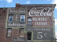 Old painted Coca-Cola advertising
