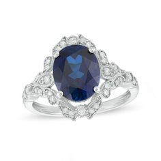 Zales Emerald-Cut Lab-Created Blue Sapphire and 1/20 CT. T.w. Diamond Frame Ring in Sterling Silver 7GCUmQmVh