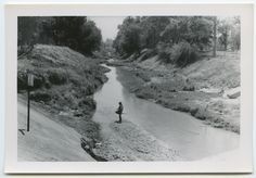 This photo of the Los Angeles River between Lindley Avenue and Reseda Blvd., just North of Victory Blvd., in the San Fernando Valley, was taken by Homer Halverson as part of his work with the United States Army Corps of Engineers, January 1955. Homer Halverson Collection. Water Works - Documenting Water History in Los Angeles.