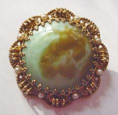 1960's Brooch: Green and Brown Marbled Glass Cabochon set in a gold tone antiqued ornate setting with 8 glass pearls by RetroroxJewellery on Etsy