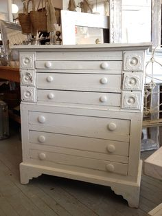 old handmade farmhouse chest of drawers made with drawers from a sewing table