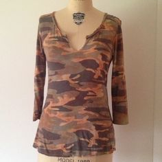 """Cami Hi Lo Tie Dye Tee Soft camouflage tee shirt made by GLIMA that has a tie dye wash over it. The neckline is distressed raw edge style. Hi Lo Measures 24"""" from shoulder to hem in the front and 26"""" in the back. The sleeves are 19"""" and the chest is about 19"""" across when flat. 100% cotton. Made in the USA. From Nordstrom. tradesPP. Glima Tops"""