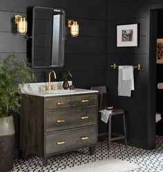 Rejuvenation vanity. Love the chair  with the small vanity and the large planter with green plant!