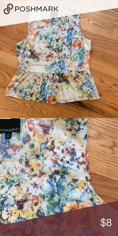 Floral Peplum Sleeveless Top Floral peplum sleeveless top. 100% polyester. Excellent condition. Nice for layering. Comment with any questions or make an offer.  trades. Cynthia Rowley Tops Tank Tops