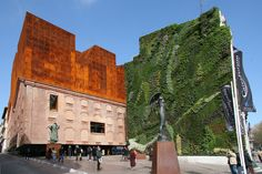 Herzog de Meuron, Caixa Forum, Madrid. The cor-ten steel above has a pattern cut out of it so that the upper levels can see out through the facade, whilst from the ground it looks like a single mass.